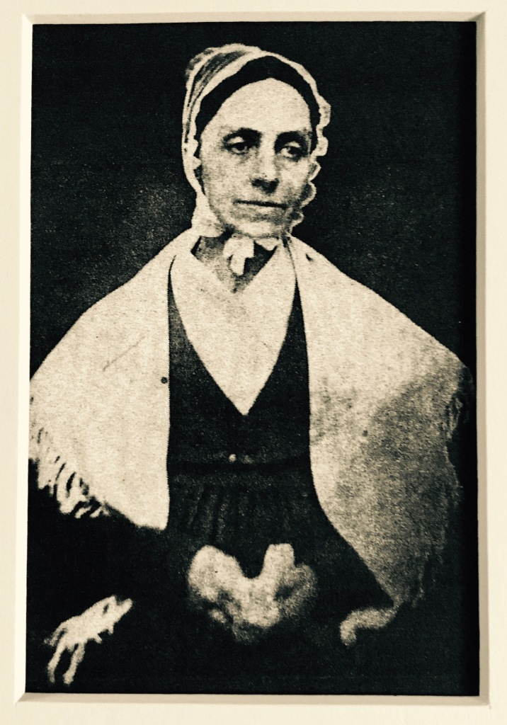 quaker woman wearing cap and shawl