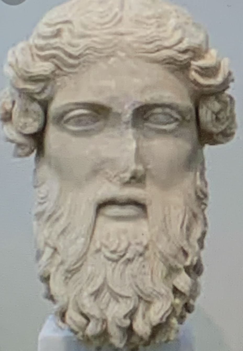 marble carved male head with beard