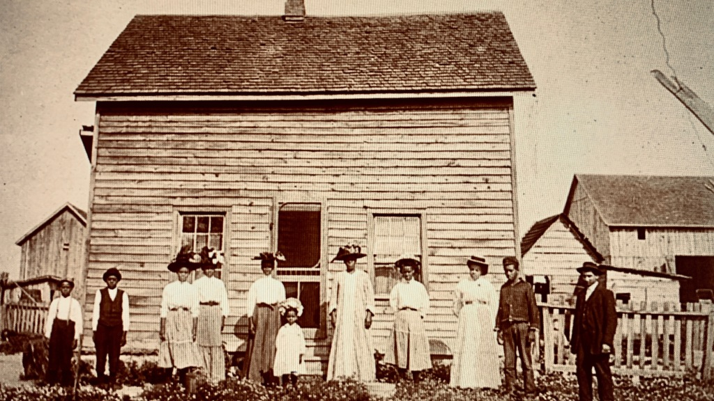 black canadians outside farmhouse