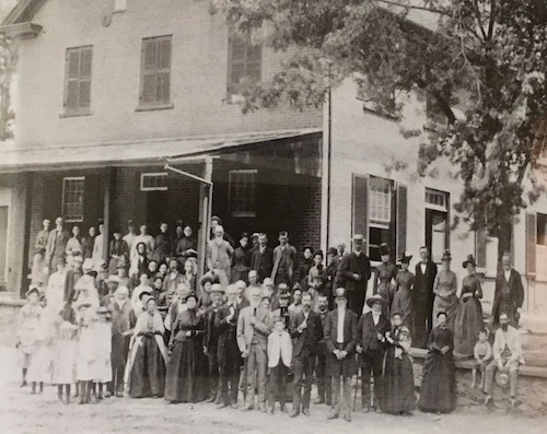 19th century quakers standing outside meetinghouse